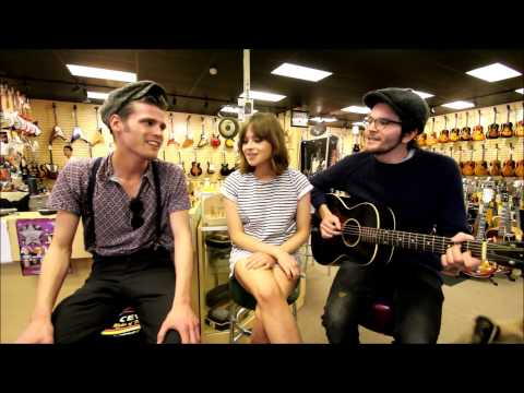 Gabrielle Aplin and Hudson Taylor singing at Norman's Rare Guitars