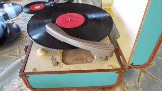 RCA blue / oirange record player playing a 33.3 RPM LP record