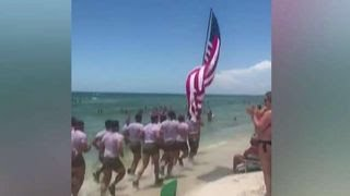 Proud Americans cheer on the US military on Panama Beach