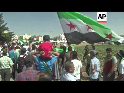 Syrian expatriates vote in Syrian elections; no voting allowed in Paris; refugees; protests