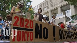 Protesters in Tokyo march on Olympic Opening Ceremonies