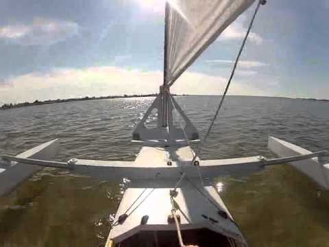 Can Your Trimaran Do This?: Launching my newest trimaran takes well under 5 minutes -- more like 2 minutes! Just push it off the trailer, point it out to sea, hop in, deploy the amas, and raise the mast & sail (all from within the cockpit) and off you go!