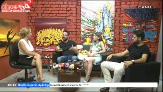 Hilal Ergenekon sitting with crossed legs - 16 08 2016 2017 Video