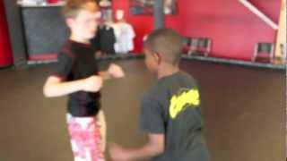 Alan Belcher MMA Club: Chaos Kids- Quinten demonstrates arm bar off of the double leg