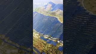 Thousands of photovoltaic panels are installed on the mountaintop of N China's Shanxi