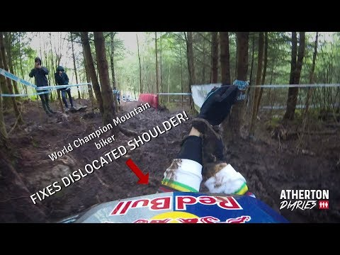 Downhill Mountain-bike World Champion Rachel Atherton fixes her dislocated shoulder trackside!