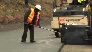 Mighty Machines. Compactors and Dump Trucks Build a Road