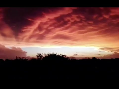 Massive thunderstorm creates orange glow over Argentina sky