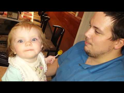 Lily sharing her lollipop with Daddy