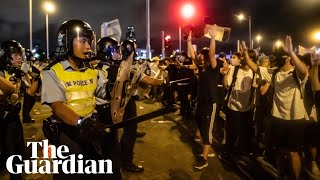 Police use batons and pepper spray on Hong Kong protesters