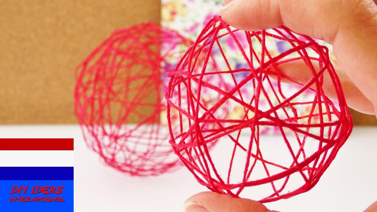 Decoratieve bollen van draad lentedecoratie van draad for Zelf decoratie maken