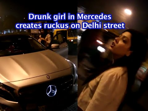 Drunk girl in Mercedes fights with cops on Delhi street | INDIA VIDEO