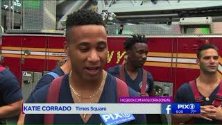 FDNY Calendar of Heroes models turn up the heat in Times Square
