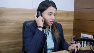 Indian young female manager talking over the phone