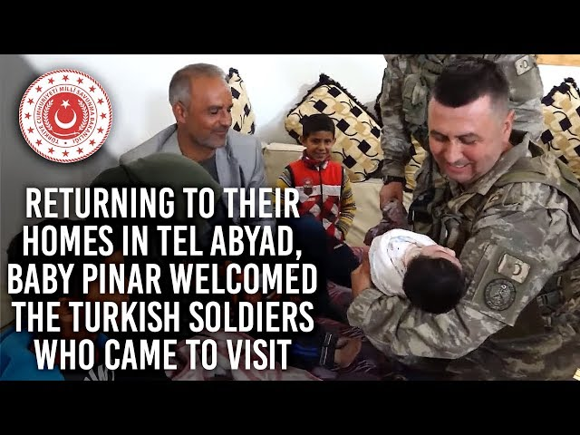Returning to their homes in Tel Abyad, baby Pinar welcomed the Turkish soldiers who came to visit