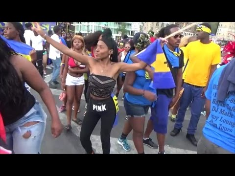 BEAUTIFUL BARBADOS CARIBBEAN GIRLS DANCE AROUND THE BARBADOS ISLAND FLOAT TRUCK AT CARNIVAL 2016