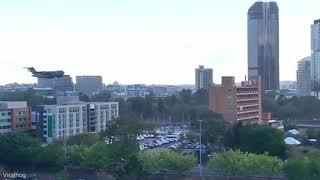 Flying plane between buildings |