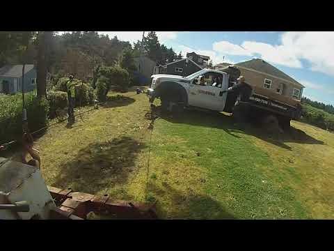 Dump Truck Backed On A  Drain Field