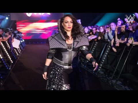 Nia Jax absent due to an injured back