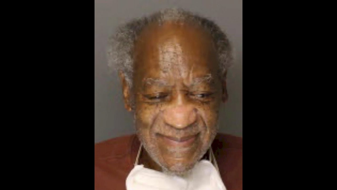 Bill Cosby seen grinning in newly released mug shot
