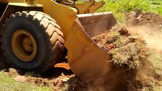 Cuting road with weel loader