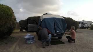 Setting up a DAC Explorer 2 tent on a Honda Element
