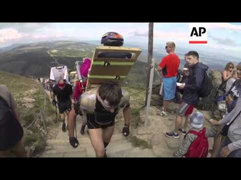 Super-fit climbers carry disabled people up mountains