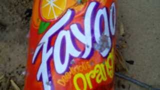 Kaveman in .22 pistol VS Faygo 2 liter orange.