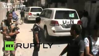 Syria: UN weapons inspectors examine site of alleged chemical strike