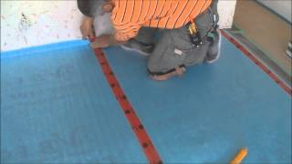 Installing The Underlayment For Laminate Flooring Installation On Wood