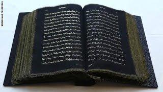 أول نسخة قرآن مكتوبة على الحرير من صنع فنانة أذربيجانية
