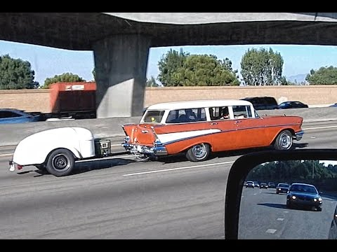 1957 Chevrolet Bel Air Station Wagon On The Freeway HD