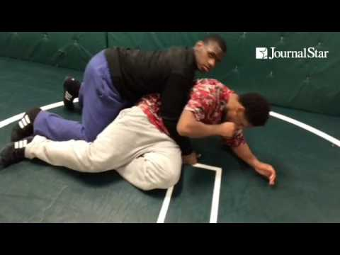 Richwoods High School wrestlers demonstrate illegal moves that officials will stop during a match