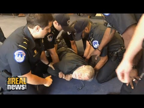 Police Brutalize 78-Year-Old CIA Whistleblower Protesting at Torturer Gina Haspel's Senate Hearing