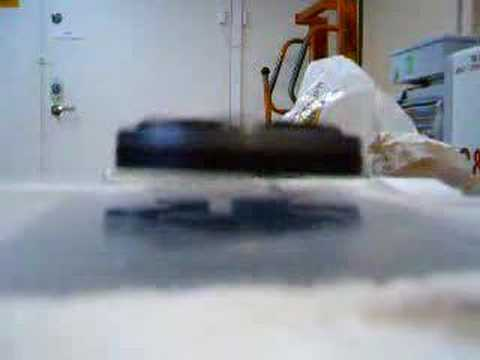 Rotating magnet levitating over superconductor