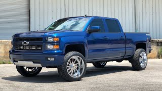 2015 Silverado with a 3 inch Motofab leveling kit, 22x12s and 33s