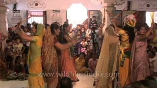 Indian girls sing and dance during the festival of Janmashtami