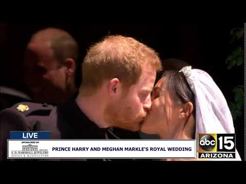 THE KISS: Prince Harry and Meghan Markle are the Duke and Duchess of Sussex