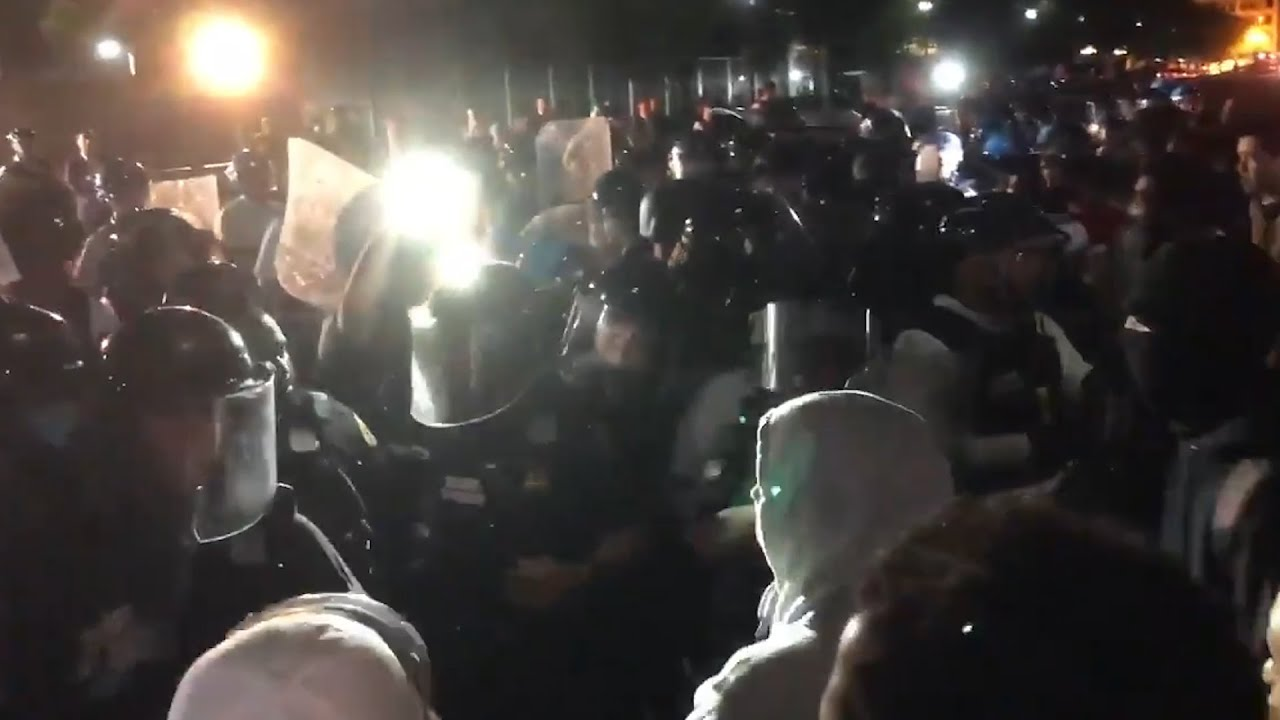 Protesters march peacefully before looters break into retail stores in ...
