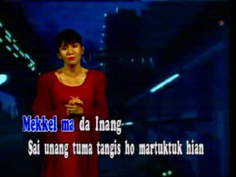 Christine Panjaitan - Borhat Ma Dainang (with caption)