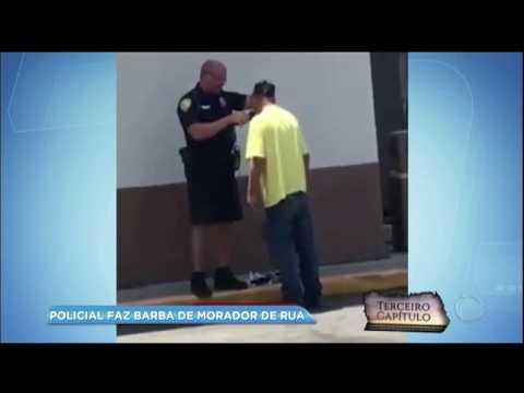 Policial é flagrado fazendo a barba de morador de rua