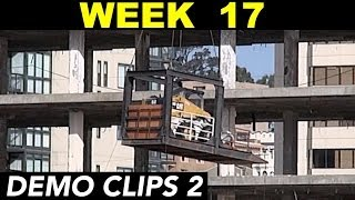 Moving demolition heavy equipment from level to level by crane (Week 17 set 2)