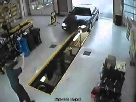 Car Falls Into Oil Changing Bay