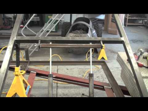 fitting the hydraulic rams on the trailer