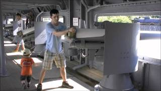 Sightseeing in Japan:  My son, Aden, and Dad, James, aiming Gun on Battleship Memorial Makasa