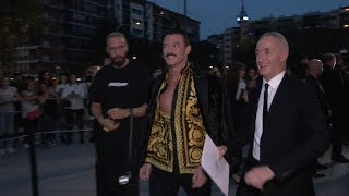 Luke Evans, Rosie Huntington Whiteley and more arrive at Versace Fashion Show in Milan