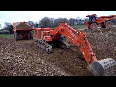 Hitachi Excavator Digging A Trench On A Road Construction Site