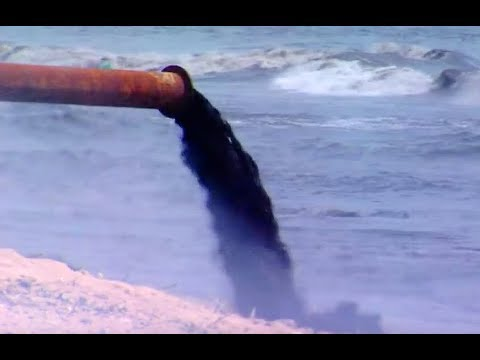 Raw sewage pouring into the ocean.