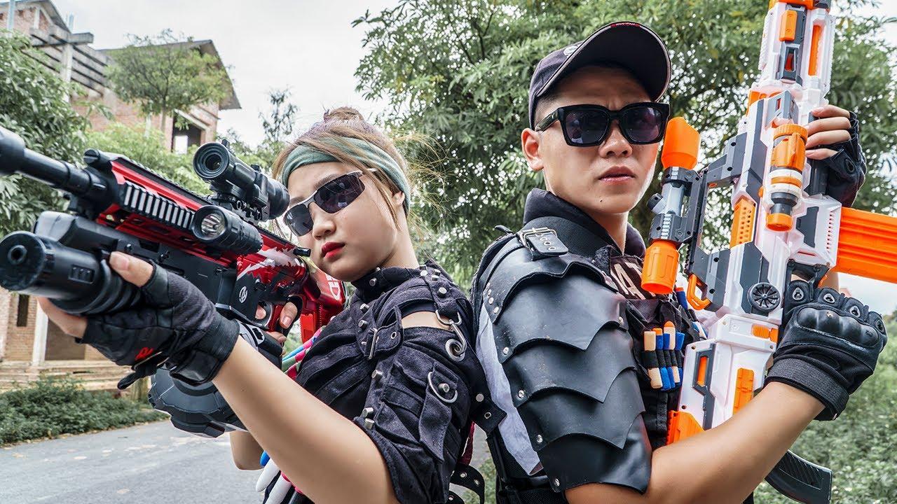 LTT Game Nerf War : Couple Warriors SEAL X Nerf Guns Fight Braum Crazy Madam Rescue Detainees