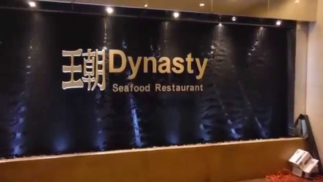 black scored acrylic waterfall wall with raised logo at dynasty